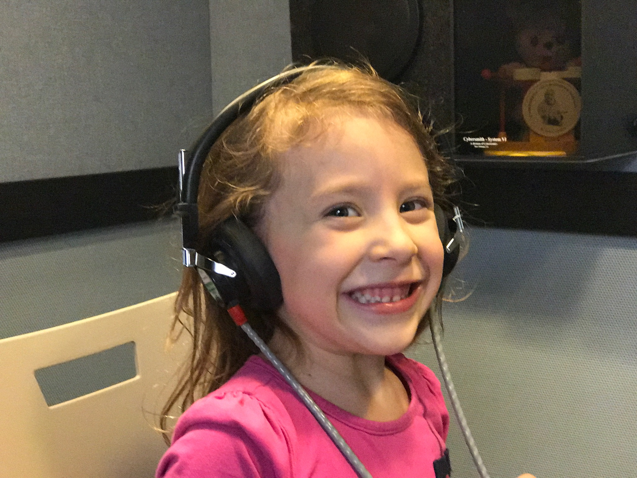 Pediatric patient is excited to have her hearing tested at the UWSHC.