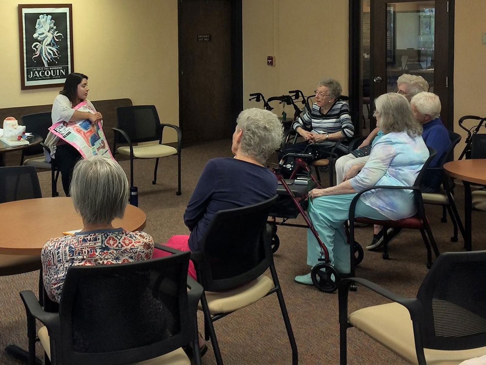 An Au.D. student presents information on hearing and hearing loss to members of a local retirement community.