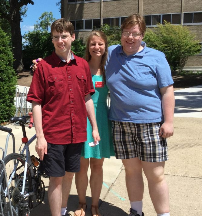 UW Speech and Hearing Graduate SLP outside Goodnight Hall with two group members.